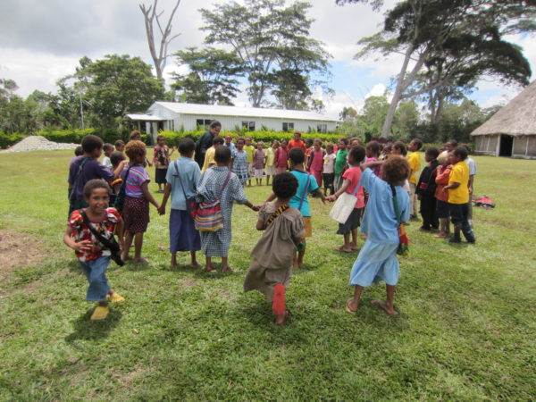 children from papua new guinea standing in a circle